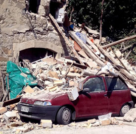 epa05508648 A view of collapsed and damaged houses and cars after the earthquake in Pescara del Tronto, central Italy, 24 August 2016, following a 6.2 magnitude earthquake, according to the United States Geological Survey (USGS), that struck at around 3:30 am local time (1:30 am GMT). The quake was felt across a broad section of central Italy, in Umbria, Lazio and Marche Regions, including the capital Rome where people in homes in the historic center felt a long swaying followed by aftershocks. According to reports at least 37 people died in the quake. EPA/ANGELO CARCONI EPA/CLAUDIO ACCOGLI